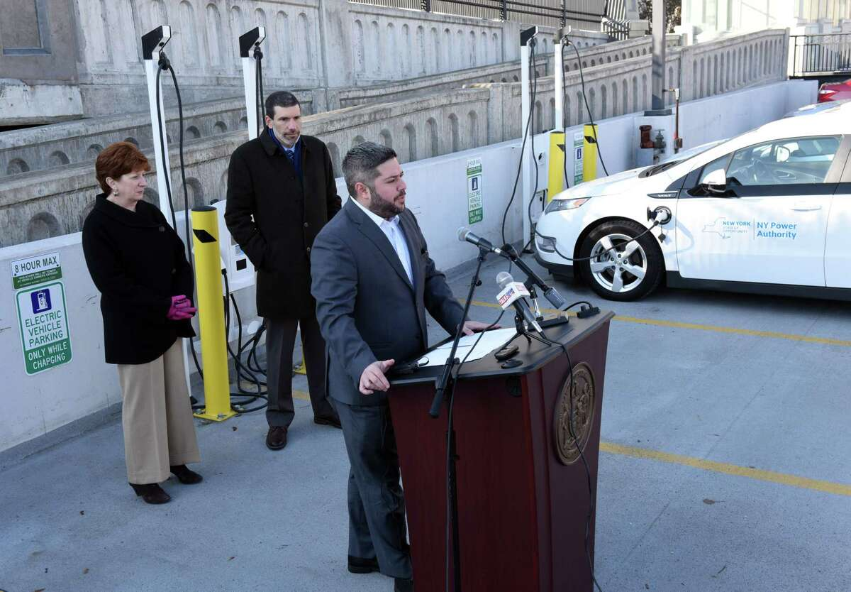 Albany Parking Authority Executive Director Matthew Peter, shown speaking during a 2019 unveiling of electric charging stations at Riverfront Garage in Albany, is a board member of the nonprofits Feed Albany and the Capital Region Restaurant Fund. (Will Waldron/Times Union)