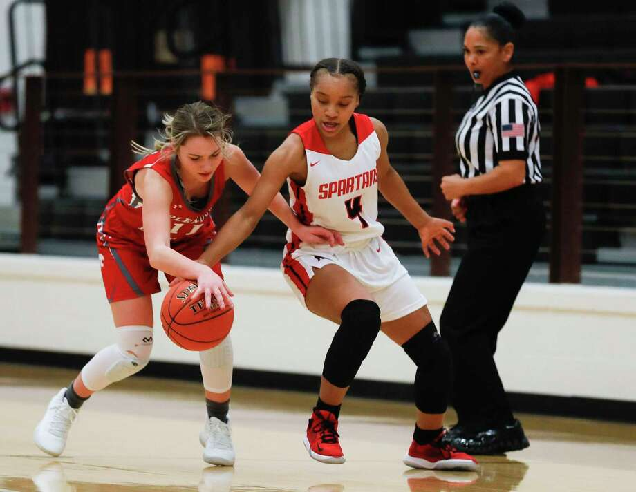 Porter point guard Mikayla Scott (4) is fouled by Splendora guard Bree Bowers (11) as she knocks the ball away during the first quarter of a non-district high school basketball game at Porter High School, Tuesday, Nov. 26, 2019, in Porter. Photo: Jason Fochtman, Houston Chronicle / Staff Photographer / Houston Chronicle