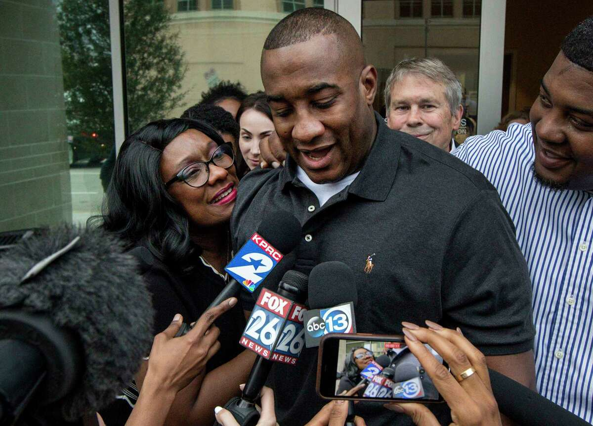 Lydell Grant, center, his mother Donna Poe, left, and brother Alonzo Poe, right, talk to reporters after Grant's release on bond on Tuesday, Nov. 26, 2019, in Houston. Earlier in the day, Grant was ordered released on bond after prosecutors and defense attorneys with the Innocence Project of Texas agreed that Grant should be released while the case is investigated further in light of new DNA evidence. Grant was convicted of capital murder in the 2010 stabbing death of Aaron Scheerhoorn outside of a Montrose bar, and he had spent seven years behind bars.