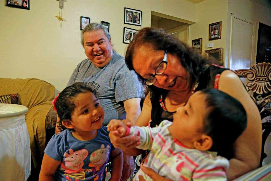 Joe and Teresa Garcia, who are raising their grandchildren Izabella, left, and Ashley Marie, were told they were being evicted from their SAHA apartment after their daughter was arrested on a marijuana charge. Photo: Ronald Cortes / 2019 Ronald Cortes