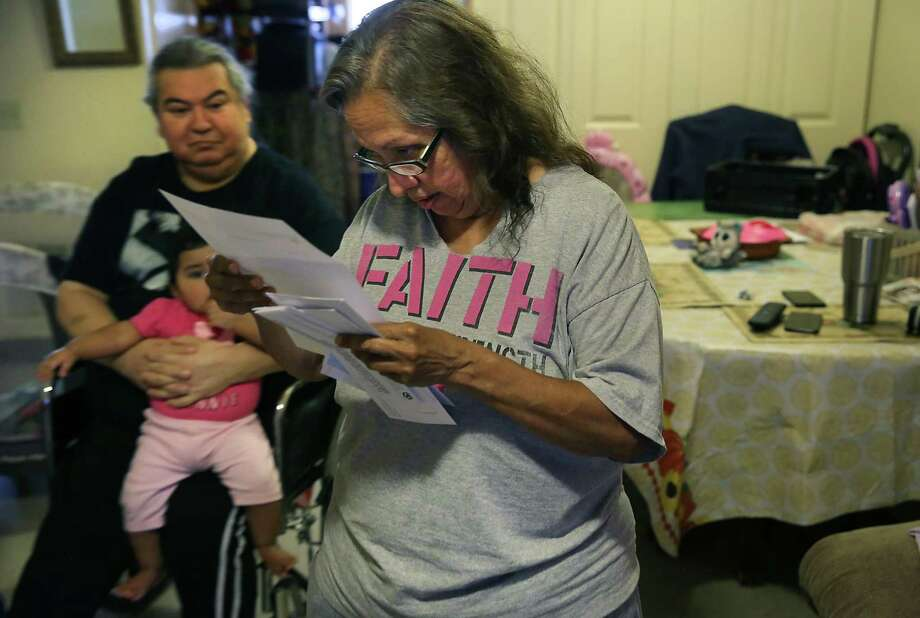 After the San Antonio Housing Authority dropped its eviction case against Joe and Teresa Garcia, the agency notified the couple about a pending rent increase. Teresa, 63, and Joe, 61, with granddaughter Ashley Marie, fear they will be priced out of the apartment. Photo: Bob Owen / ©2019 San Antonio Express-News