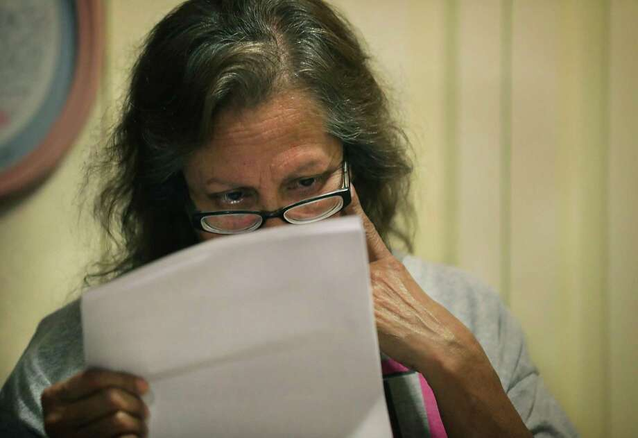 Teresa Garcia, 63, reads the rent-increase letter from SAHA. Photo: Bob Owen / ©2019 San Antonio Express-News