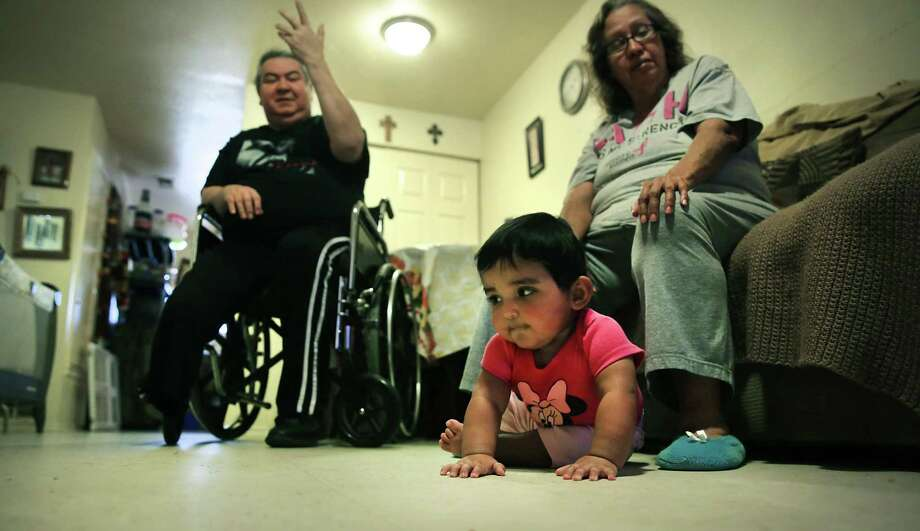 Teresa and Joe Garcia are raising their granddaughters in their apartment, but they were almost evicted this summer. Ashley Marie is starting to crawl. / ©2019 San Antonio Express-News