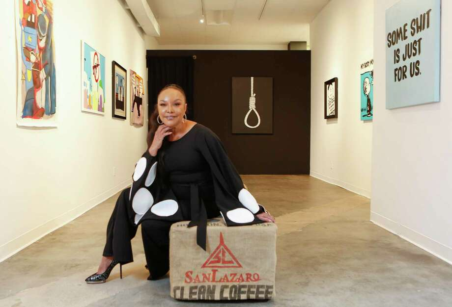 """Actress Lynn Whitfield recently visited Houston for an intimate event with Grammy-award winning singer Yolanda Adams at the Winston Contemporary Art Gallery on Kirby. In the background is a painting of a noose by Rico Edwards that's part of his exhibit, """"The Problems We Still Live With."""" Winfield said the painting was powerful. Photo: Steve Gonzales, Houston Chronicle / Staff Photographer / © 2019 Houston Chronicle"""