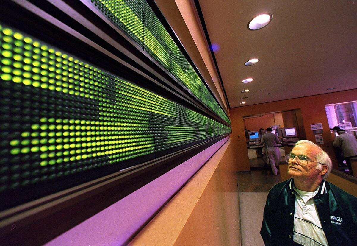 STOCKS 1/C/04APR97/BU/CS - Investor Richard Finkes (cq), 55, watches the stocks streak by on the electronic ticker tape at Charles Schwab & Company, 101 Montgomery Street, SF. SAN FRANCISCO CHRONICLE PHOTO BY CHRIS STEWART