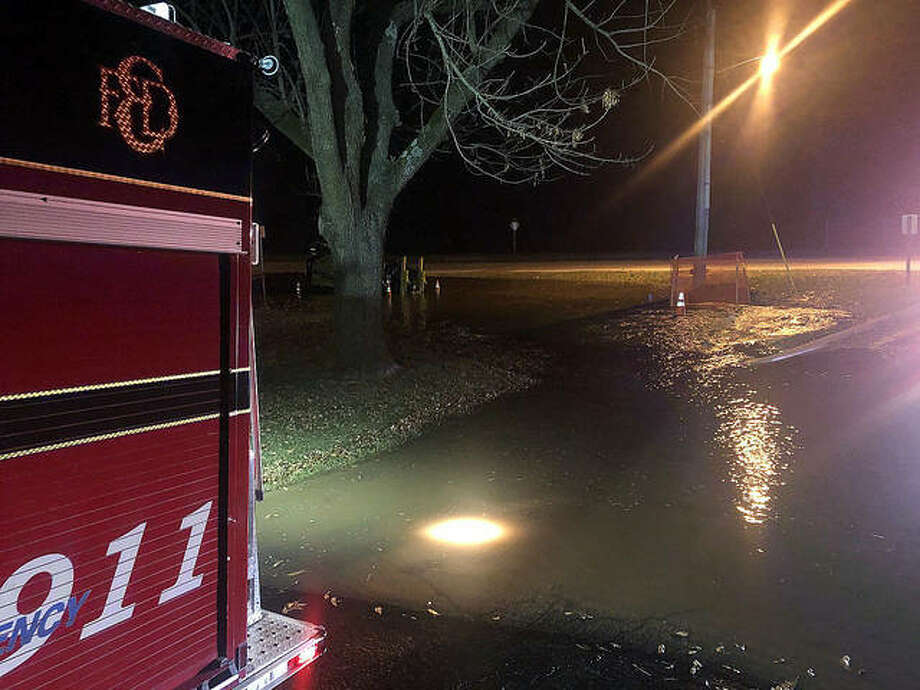 Water pools onto the grounds of Woodland Elementary School Monday night along Route 157. Photo: Brittany Johnson The Intelligencer