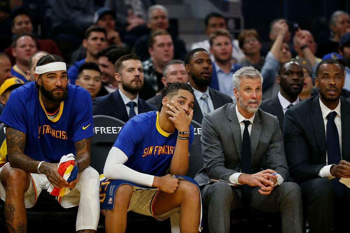 (L-R) Willie Cauley-Stein #2, Jordan Poole #3, Assistant Coches Bruce Fraser and Mike Brown are seen from the sideline during the second quarter of their NBA basketball game agains the Portland Trailblazers at Chase Center on Monday, November 4, 2019 in San Francisco, California.