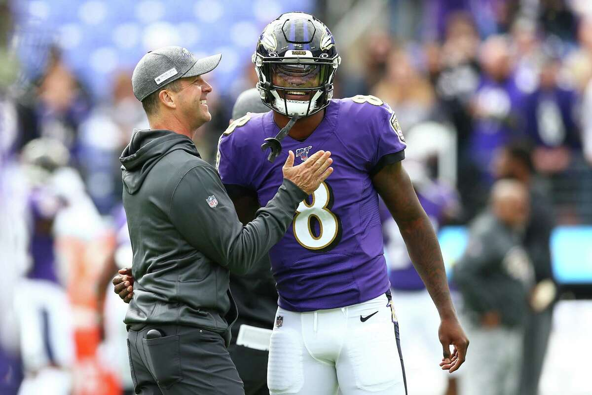 Ravens quarterback, Lamar Jackson, speaking with coach John Harbaugh, threw 5 TDs in a 45-6 victory over the Rams.