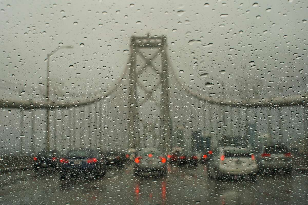 Cars sit in traffic on the Bay Bridge during a rainstorm in San Francisco, California, on Tuesday, Nov. 26, 2019.