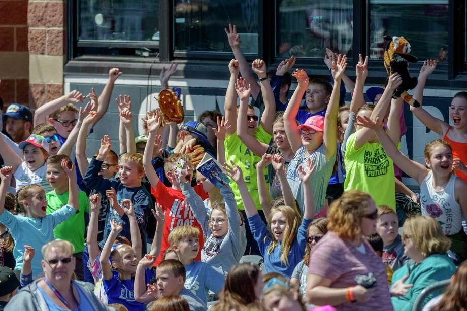 MLB's proposal to contract its minor league system, if adopted, would mean that these children will someday not be able to watch the West Virginia Power, one of 42 teams on the cut list. Photo: Craig Hudson / Associated Press / © Craig Hudson / Charleston Gazette-Mail