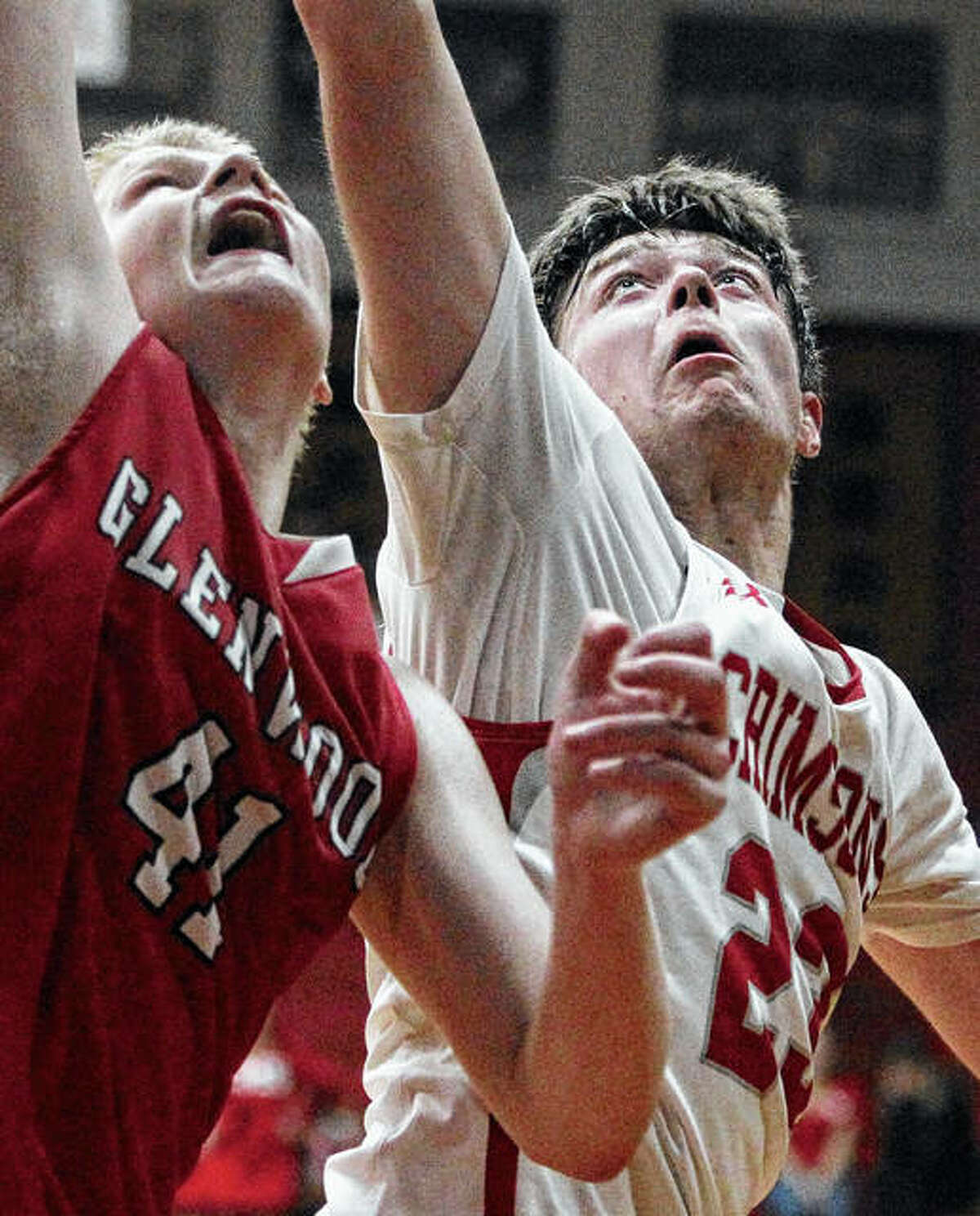 Jacksonville's Will Rohlk (right) goes up for a rebound during Tuesday's game against Chatham.