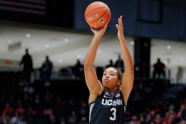 UConn's Megan Walker, seen shooting a 3-pointer against Dayton last week, has emerged an an impact player for the Huskies.