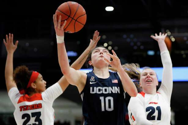 UConn's Molly Bent shoots against Dayton's Erin Whalen (21) and Mariah Perez during a game in November.
