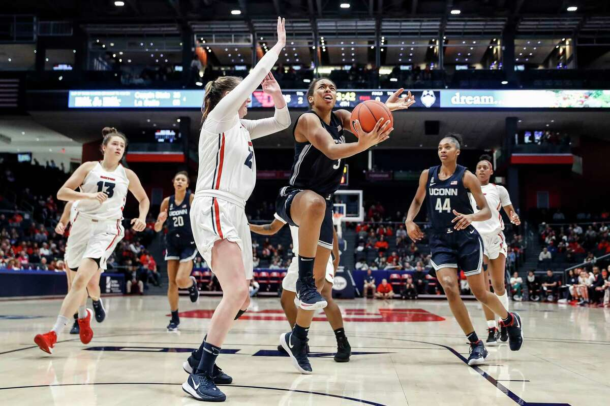 UConn's Megan Walker drives to the basket against Dayton last week.