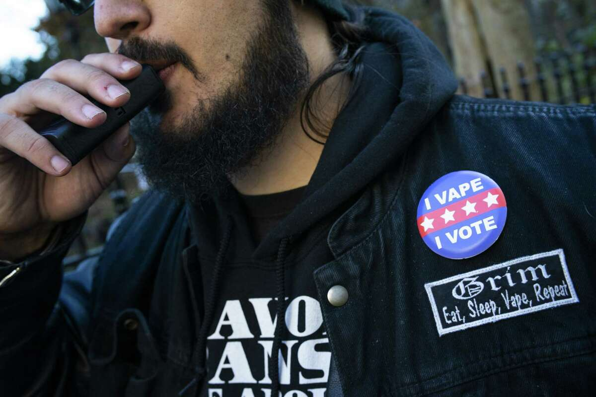 NEW YORK, NY - NOVEMBER 26: A man vapes as people protest against the New York City Council vote on legislation to ban flavored e-cigarettes outside City Hall on November 26, 2019 in New York City. New York is voting to be the first big city to ban flavored e-cigarettes and comes days after New Yorks second vaping death. (Photo by Eduardo Munoz Alvarez/Getty Images)