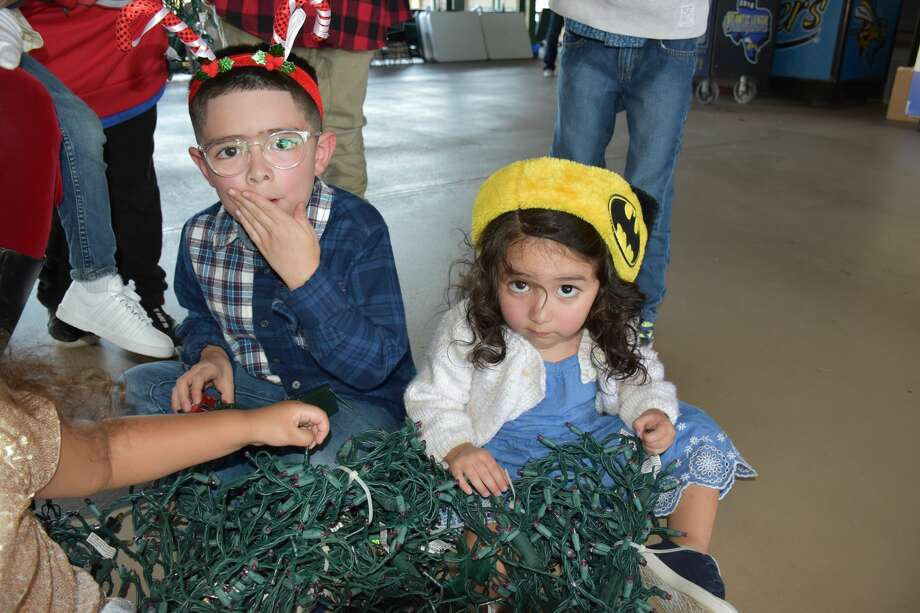 Isaiah and Mila Cano enjoy touching some Christmas lights. As part of its annual Holiday Lights program, the Sugar Land Skeeters are joining forces with Hope For Three Autism Advocates for a sensory-friendly event from 6 to 9 p.m. Thursday, Dec. 5. Photo: Courtesy Of Hope For Three