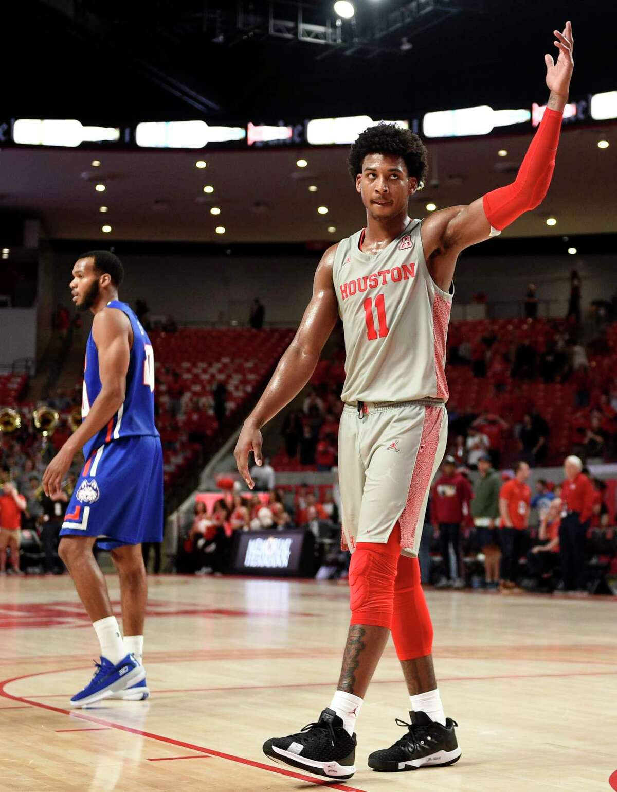 Houston guard Nate Hinton (11) acknowledges the crowd after the team's win over Houston Baptist in an NCAA college basketball game, Tuesday, Nov. 26, 2019, in Houston.