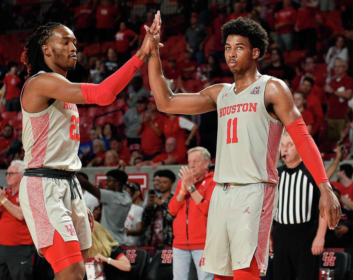 Houston guard Nate Hinton (11) celebrates the team's win over Houston Baptist with Cedrick Alley Jr. in an NCAA college basketball game, Tuesday, Nov. 26, 2019, in Houston.