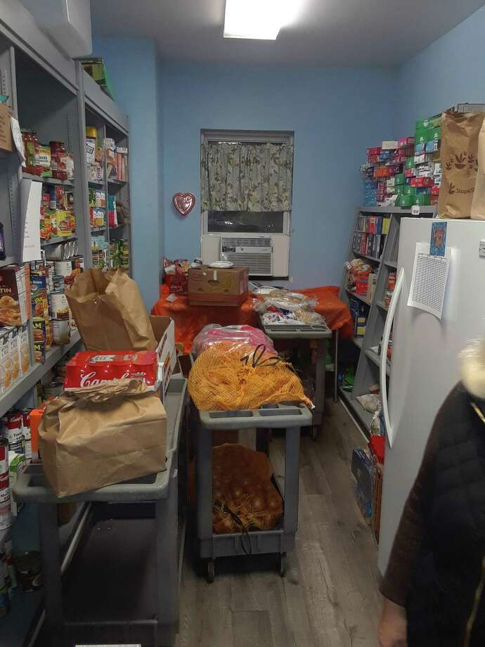 The pantry at FISH/Friends in Service to Humanity in Torrington, is packed with food donations. Photo: Emily M. Olson / Hearst Connecticut Media /