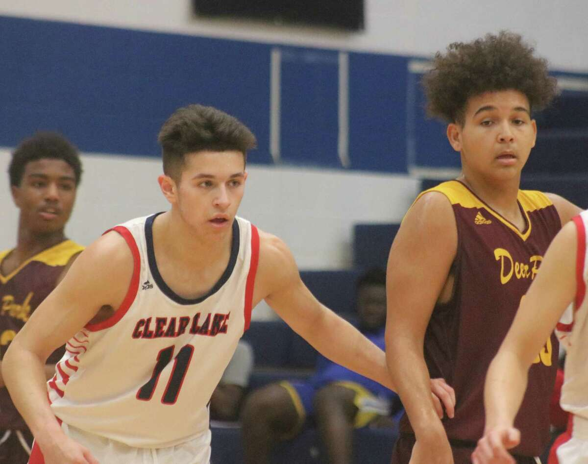 Jeffrey First keeps tabs on Deer Park's Hayden Ryals during second-half action Tuesday afternoon. First bridged the third and fourth periods with three clutch buckets, including one during the team's 9-0 run in the fourth.