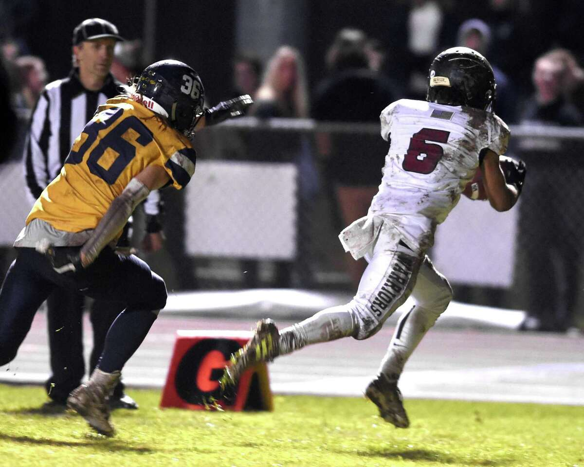 DiAngenlo Jean-Pierre of Valley Regional catches a pass against Haddam Killingworth for a touchdown in the first half on November 26, 2019.