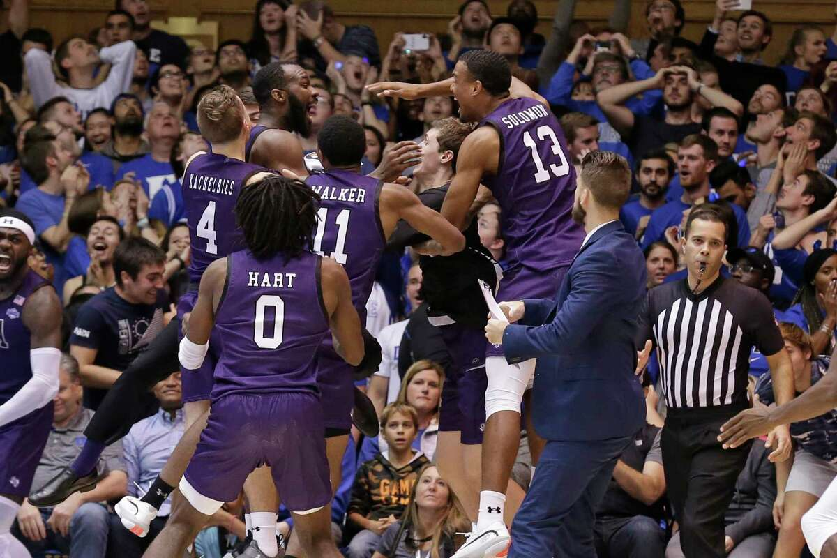 Stephen F. Austin players celebrate the team's 85-83 overtime win over Duke in an NCAA college basketball game in Durham, N.C., Tuesday, Nov. 26, 2019. (AP Photo/Gerry Broome)
