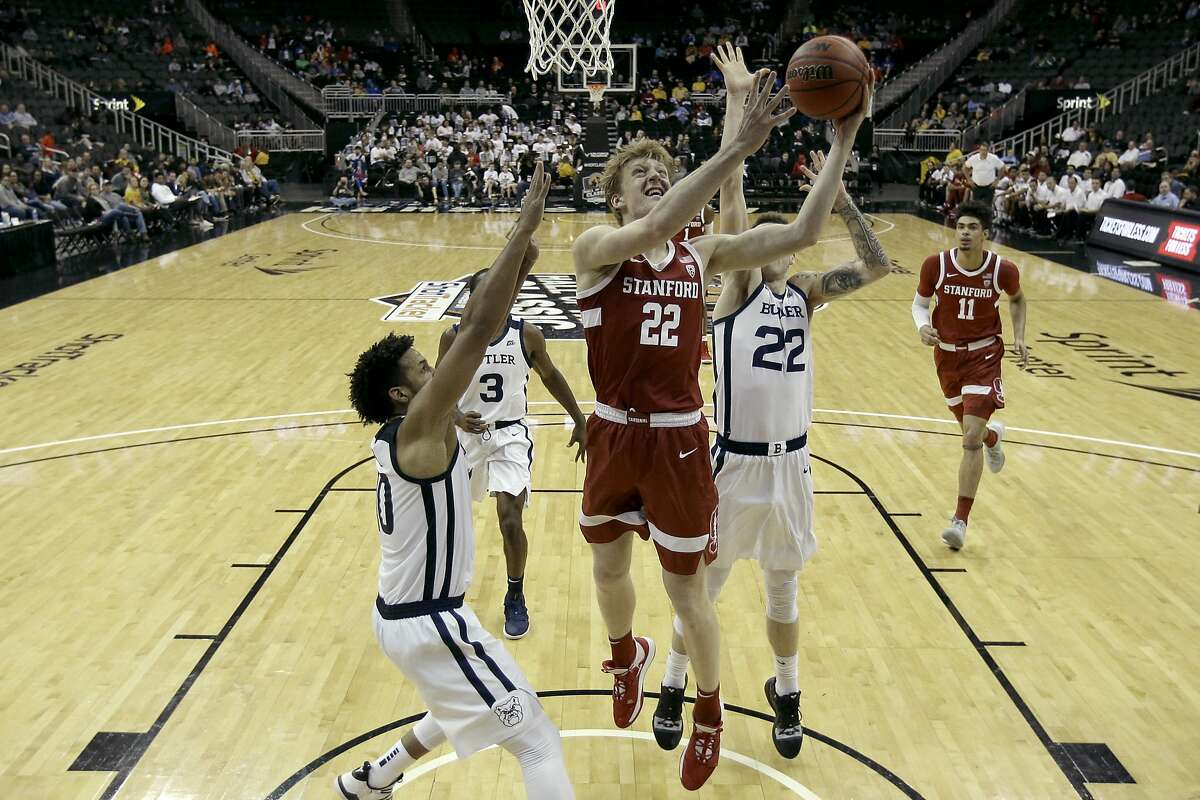 Stanford forward James Keefe shoots between Butler defenders in the Cardinal's 68-67 loss in Kansas City, Mo. It was the Cardinal's first loss after opening the season with seven wins.