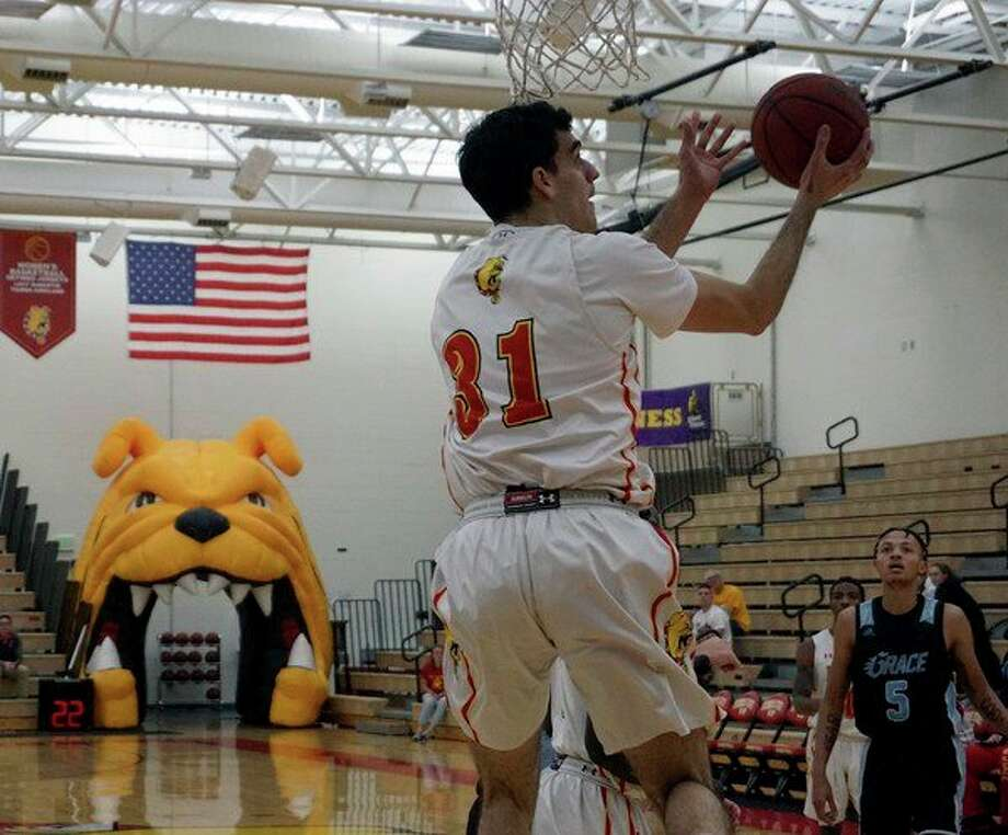 Ferris State junior Michael Peterson performs a lay-up during FSU's victory over Grace Christian on Tuesday night at Jim Wink Arena. (Pioneer photo/Joe Judd)