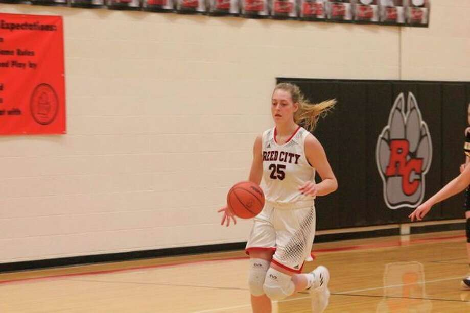Reed City's Alison Duddles dribbles down the court during action last season. (Herald Review file photo)