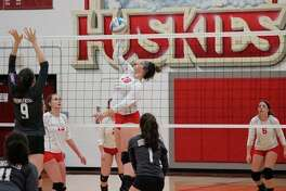 Madison Evans drives the ball over the net during a match against Leland. (File photo)