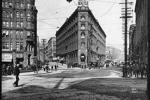 The Hotel Seattle was located near Pioneer Square, which was then the heart of Seattle's business district. The five-story brick and stone building had 200 rooms. It was close to the railroad depots, the docks, and the point where most of the city's streetcar lines started. The hotel was torn down in 1962 to make room for a parking garage. This photo shows the Hotel Seattle at the intersection of Yesler Way, James Street, and First Avenue.  	 [1983.10.6827]