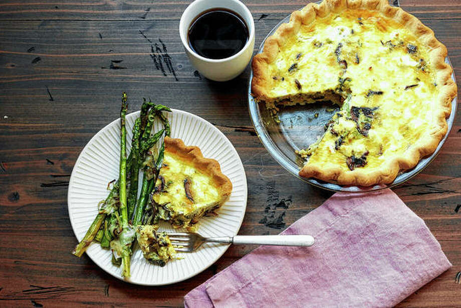 Setting out breakfast for your guests to help themselves to when they wake up in the morning is a low-stress, make-ahead way for you to offer the morning meal. Quiche, such as this leek, mushroom and goat cheese version, can easily be made in advance and refrigerated for even the early risers to find. Photo: Mia | Katie Workman Via AP