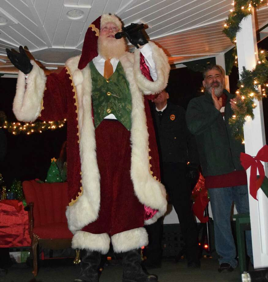 Spectrum/The annual lighting of the trees on the Village Green in New Milford was held Nov. 24, 2018. The event was held by the Greater New Milford Chamber of Commerce. The trees are put up annually by the United Methodist Men at the New Milford United Methodist Church. Above, Santa greets the crowd before leading the countdown to the lighting of the trees. Photo: Deborah Rose / Hearst Connecticut Media / The News-Times  / Spectrum