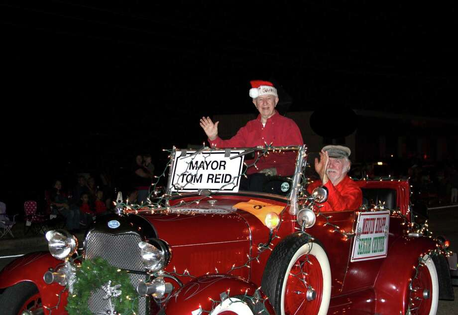 Pearland Mayor Tom Reid is among the many residents who watch or participate in the city's annual Christmas parade. The 38th annual Hometown Christmas Parade will start at 6 p.m. Saturday, Dec. 7. The parade route begins at Old Alvin Road and will travel east along Broadway, ending at Pearland Parkway. Free parking is available in shopping centers along the parade route. Photo: KRISTI NIX / The Journal / The Journal