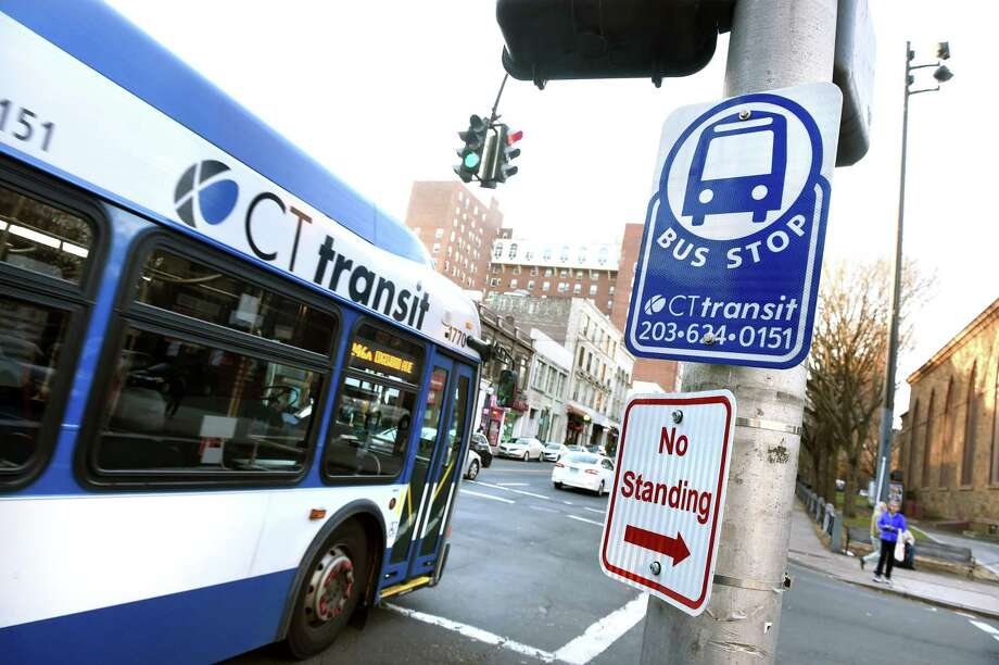 A CT Transit bus pulls away from a bus stop on Chapel Street in New Haven on November 21, 2019. Photo: Arnold Gold / Hearst Connecticut Media / New Haven Register