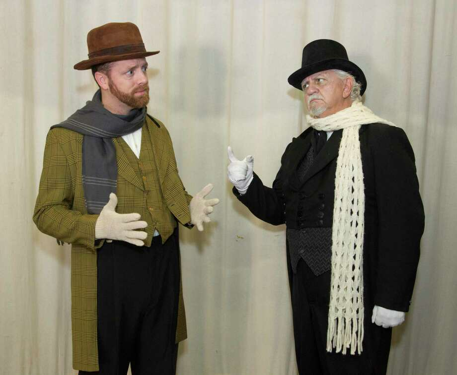 """Christopher St. James, left, plays Bob Cratchit and Rex Comer plays Scrooge in the Owen Theatre's """"A Christmas Carol - The Musical."""" Photo: Photo By Brad Meyer"""