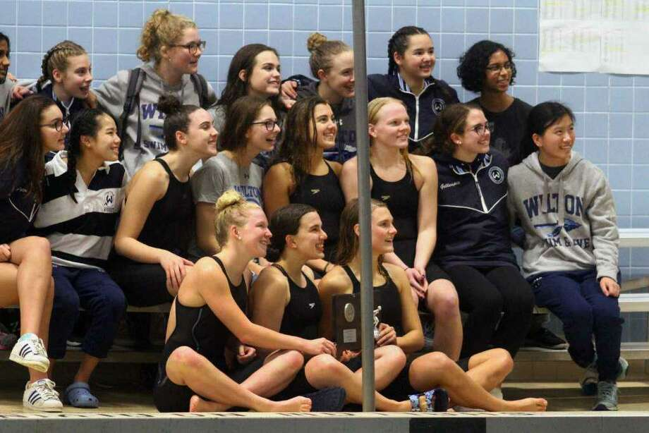 The Wilton girls swim team (shown after finishing second at the Class L championship) ended the season by placing eighth at the State Open. Photo: Christian Abraham / Hearst Connecticut Media
