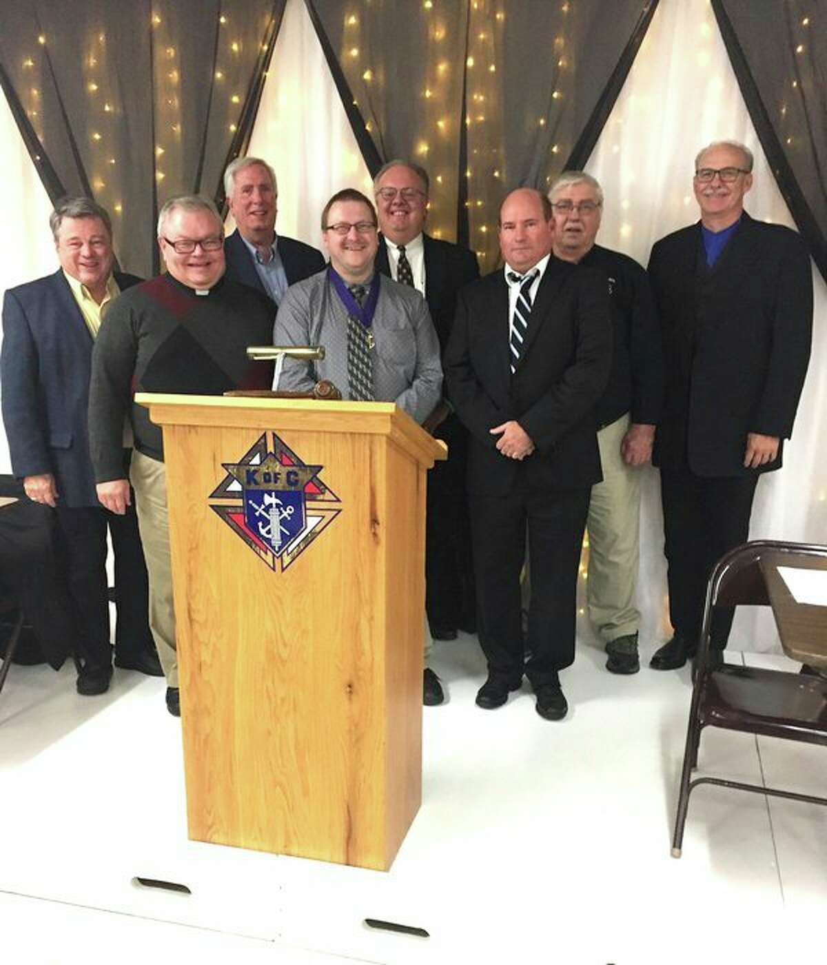 Pictured are (front row) Father T.J. Fleming, Eric Emming, K of C Grand Knight and Bill MacAlpine; (back row) Don Clark, Doug Brining, Honorable Gerald Prill, James Swartz and Deacon Jene Baughman. (Submitted Photo)