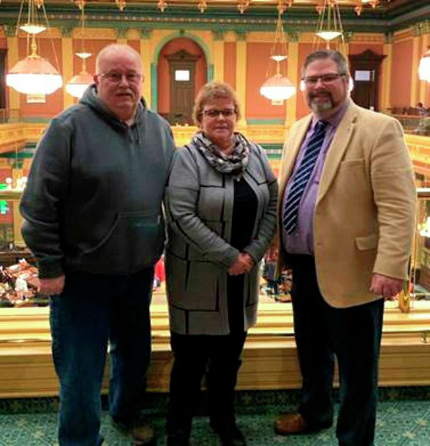 Rep. Phil Green honored Kathy and Don Zimmerman from Port Austin as one of the winners of Green's photo contest. Kathy sent in the winning photo for the family fun category and was rewarded with an invitation to the state Capitol. (Submitted Photo)