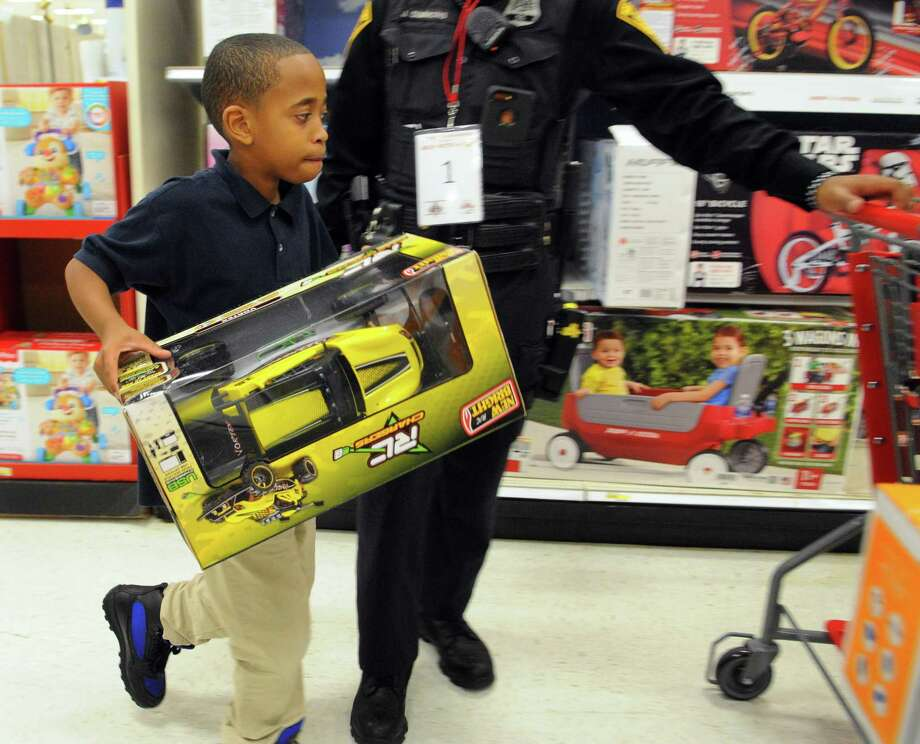 """>> Click ahead for the best Black Friday deal of 2019.   A boy participates in the annual """"Shop With A Cop"""" event in 2017 at the Connecticut Post mall in Milford, Conn. Photo: Christian Abraham / Hearst Connecticut Media / Connecticut Post"""