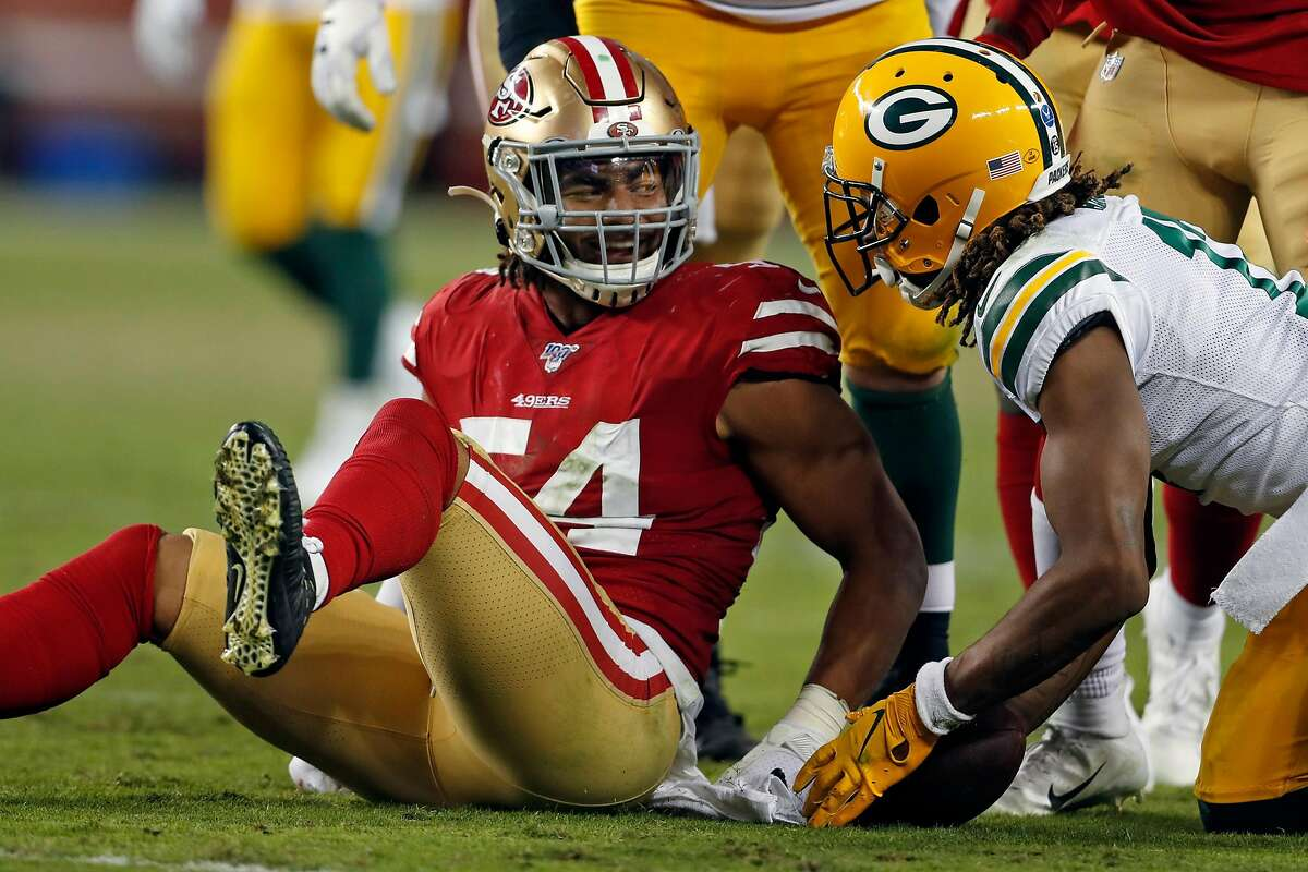 San Francisco 49ers' Fred Warner smiles at Green Bay Packers' Davante Adams after a 3rd quarter tackle during Niners' 37-8 win in NFL game at Levi's Stadium in Santa Clara, Calif., on Sunday, November 24, 2019.