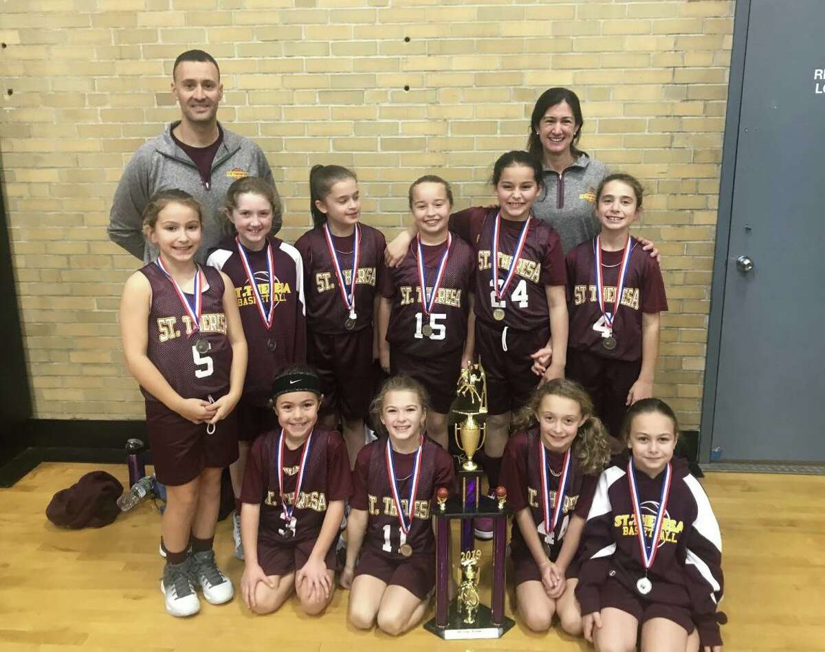 The St. Theresa's Parish 4th grade girls' basketball team won the Milford Knights Tip Off Basketball Tournament Championship. Team members (front row) are: Gianna Colon, Ava Buswell, Ashlyn Delaney and Lia Solustri; (second row) Kelly Lungi, Veronica Buckley, Gianna Holinko, Harper Delaney, Francesca DiMarco and Samantha Russo; (third row) assistant coach Frank DiMarco and head coach Traci Sacco.