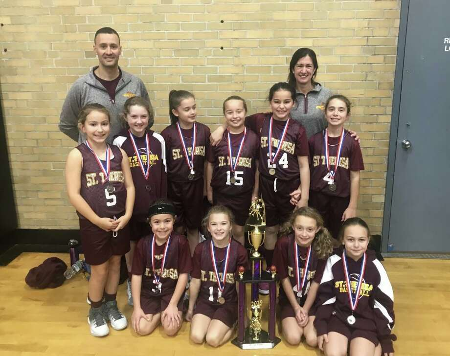 The St. Theresa's Parish 4th grade girls' basketball team won the Milford Knights Tip Off Basketball Tournament Championship. Team members (front row) are: Gianna Colon, Ava Buswell, Ashlyn Delaney and Lia Solustri; (second row) Kelly Lungi, Veronica Buckley, Gianna Holinko, Harper Delaney, Francesca DiMarco and Samantha Russo; (third row) assistant coach Frank DiMarco and head coach Traci Sacco. Photo: Contributed Photo / St. Theresa School / Trumbull Times