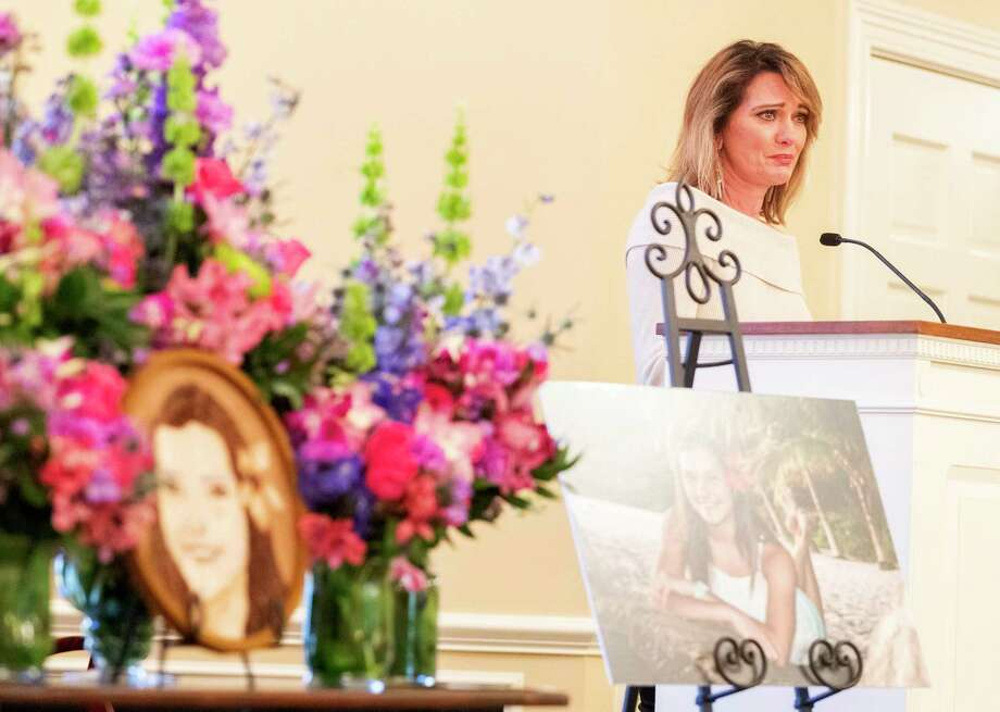 Kim Hess becomes emotional as she speaks about her daughter, Cassidy Hess, as her floragraph, a portrait made of floral and other natural materials, is unveiled at Forest Park in The Woodlands. The image of Hess, who was an organ donor, will be a part of Donate Life float at this year's 131st annual Rose Parade in Pasadena, California on Jan. 1, 2020. The College Park High School student died of suicide in December 2015. Shortly after her death, Cassidy's parents formed a nonprofit called Cassidy Joined for Hope to raise awareness about suicide. Photo: Jason Fochtman, Houston Chronicle / Staff Photographer / Houston Chronicle