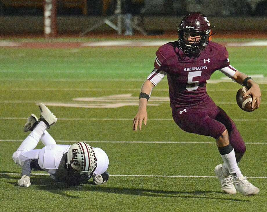 Abernathy's Jess Hoel sends a Lubbock Roosevelt defender to the ground on a run play during their District 2-3A Division II football game in Antelope Stadium earlier this season. Photo: Nathan Giese/Planview Herald