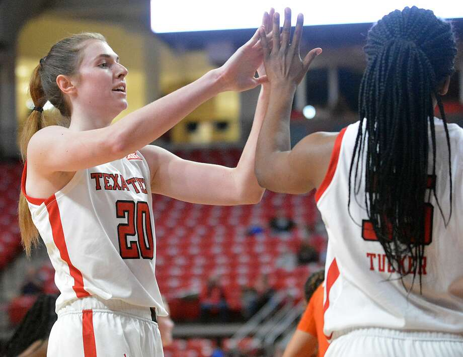 Brittany Brewer celebrates a bucket by Alexis Tucker during the Texas Tech women's basketball team's season opener against Sam Houston State. Photo: Nathan Giese/Planview Herald