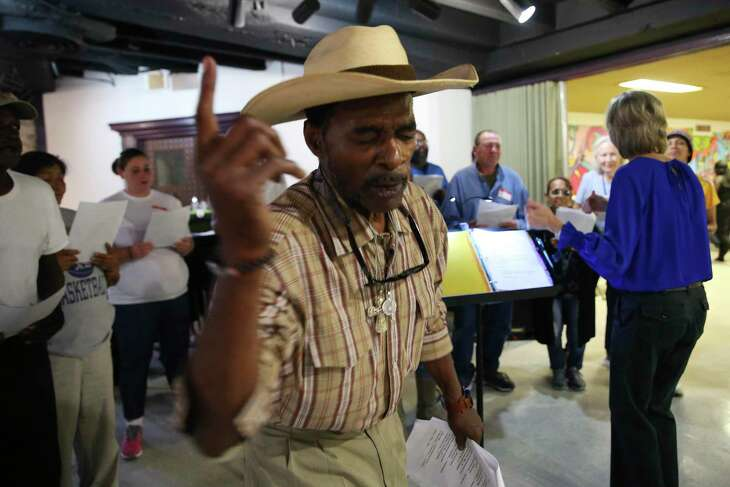 James Brown leads the Alamo City Street Choir during a short concert at Travis Park United Methodist Church, Wednesday, Oct. 23, 2019. The choir is made up of mostly homeless people.