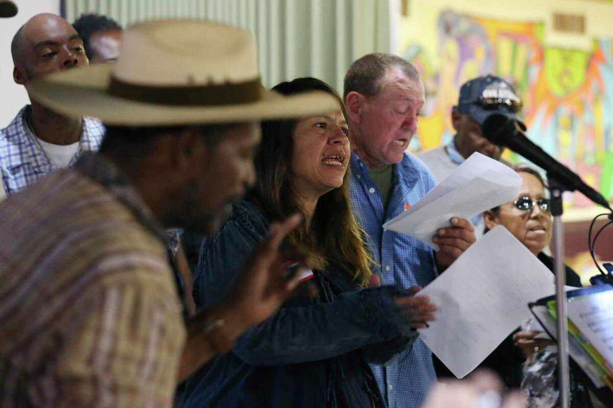Patricia Solis, center, and Gene Schafer sing with the Alamo City Street Choir during a short concert at Travis Park United Methodist Church, Wednesday, Oct. 23, 2019. The choir is made up of mostly homeless people.