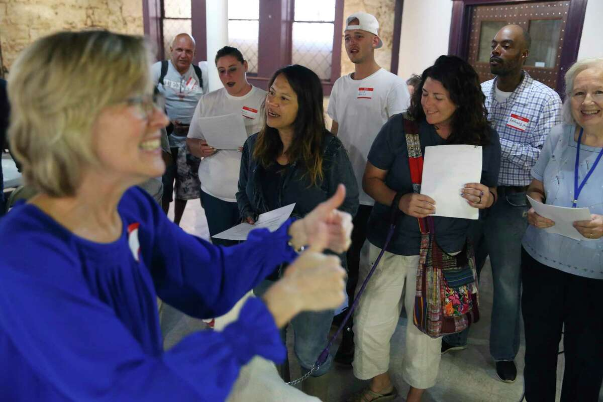 The Alamo City Street Choir, under the direction of Tracy Bjella Powers, left, performs a short concert at Travis Park United Methodist Church, Wednesday, Oct. 23, 2019. The choir is made up of mostly homeless people.