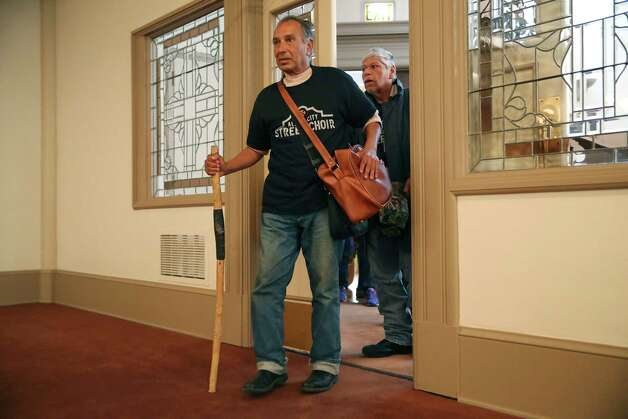 Roger Glen Garcia, 60, and others walk into the sanctuary at Travis Park Methodist Church, Sunday, Nov. 24, 2019. Garcia is with the Alamo City Street Choir, which performed during the service. Photo: Jerry Lara, San Antonio Express-News / Staff Photographer / **MANDATORY CREDIT FOR PHOTOG AND SAN ANTONIO EXPRESS-NEWS/NO SALES/MAGS OUT/TV   © 2019 San Antonio Express-News